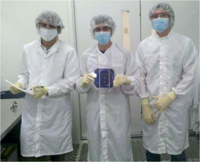 Undergraduate students working on the line at ASU building solar cells
